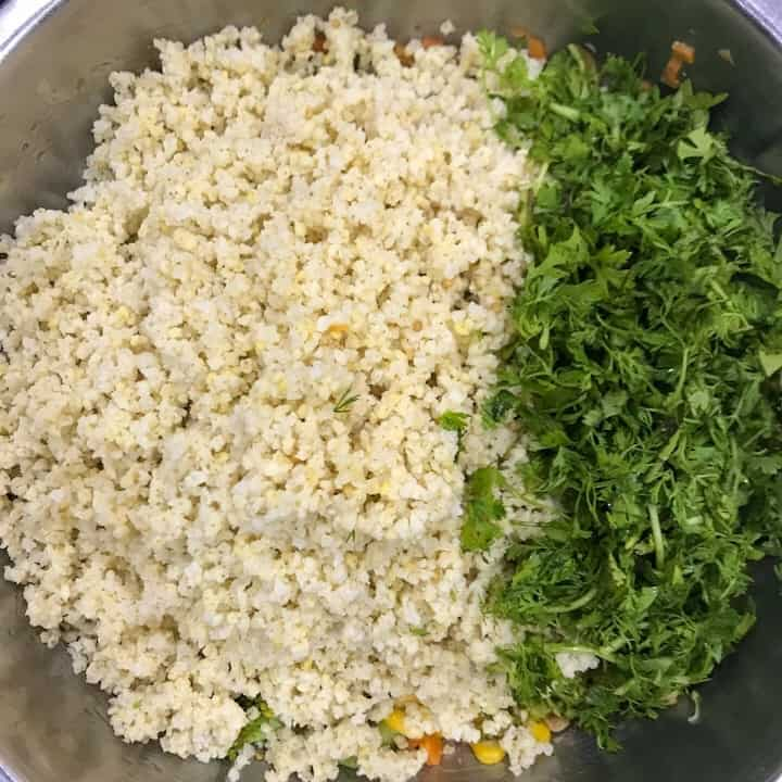 cooked millet and coriander leaves in millet salad bowl