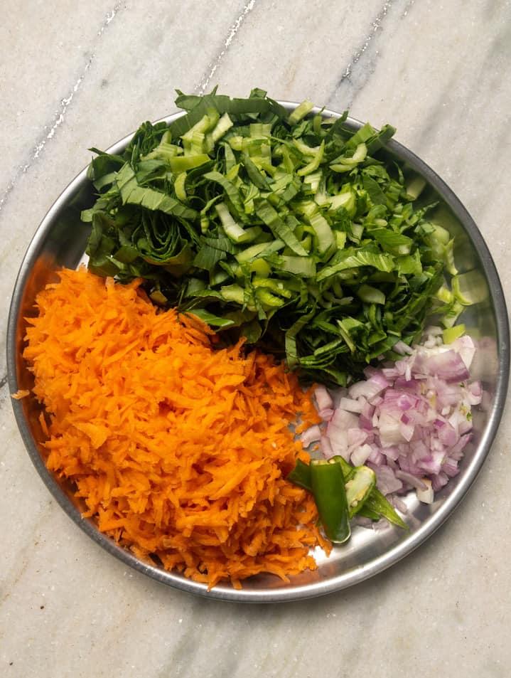 Carrot poriyal ingredients in a plate