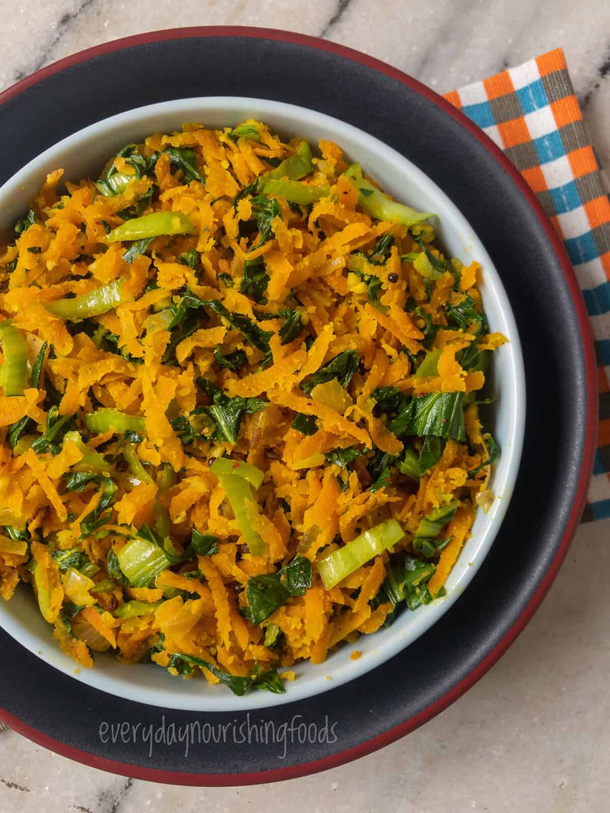 carrot curry using shredded carrots and bokchoy in a bowl.