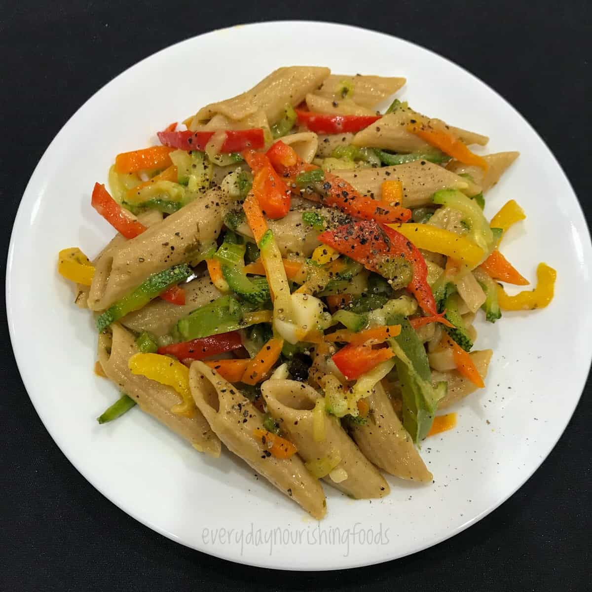 whole wheat penne pasta in a plate