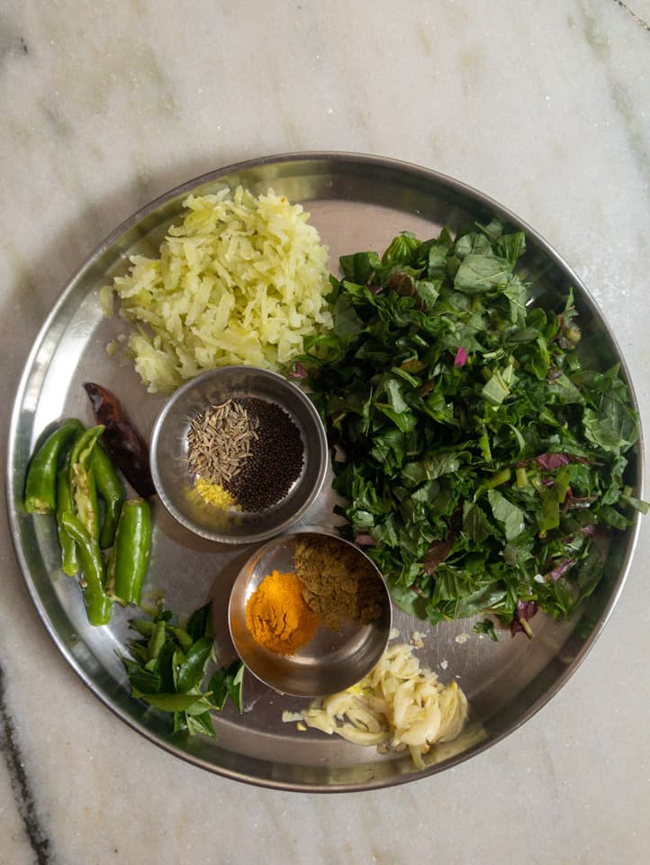 thotakura pappu ingredients in a plate
