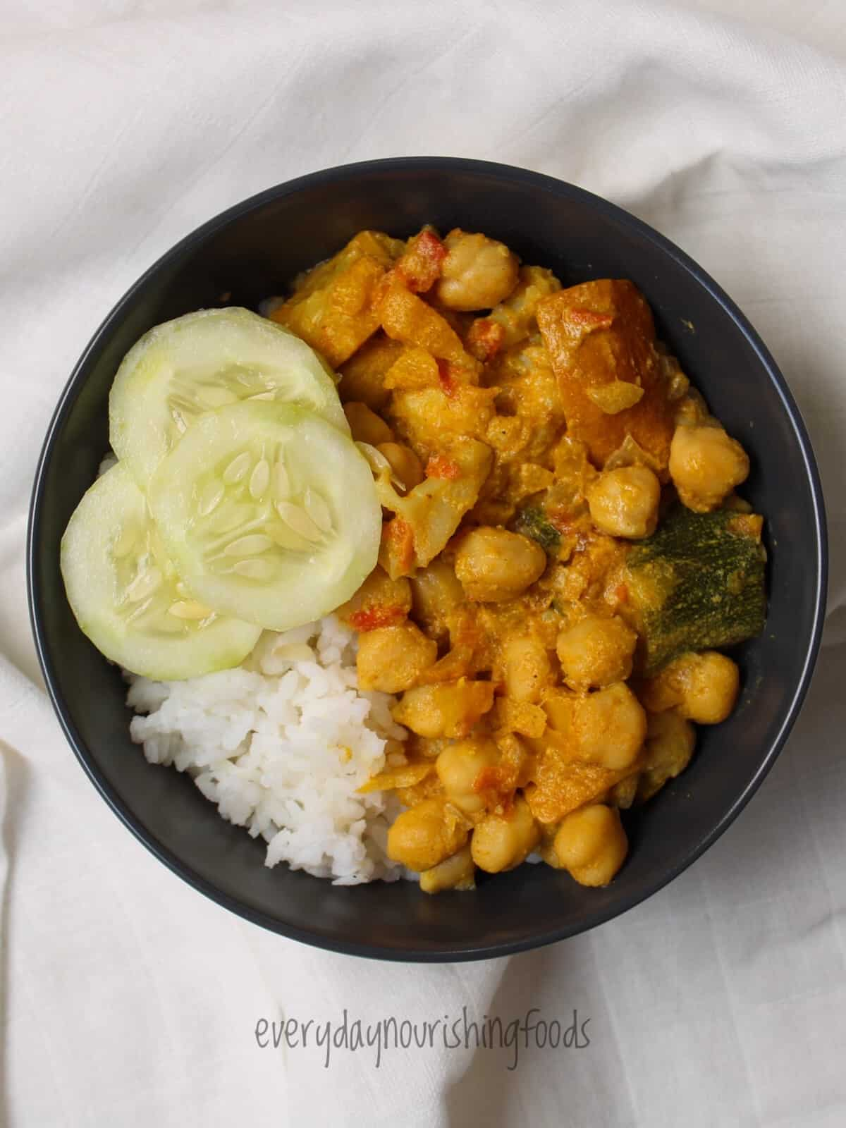vegetable curry with coconut milk and chickpeas in a bowl