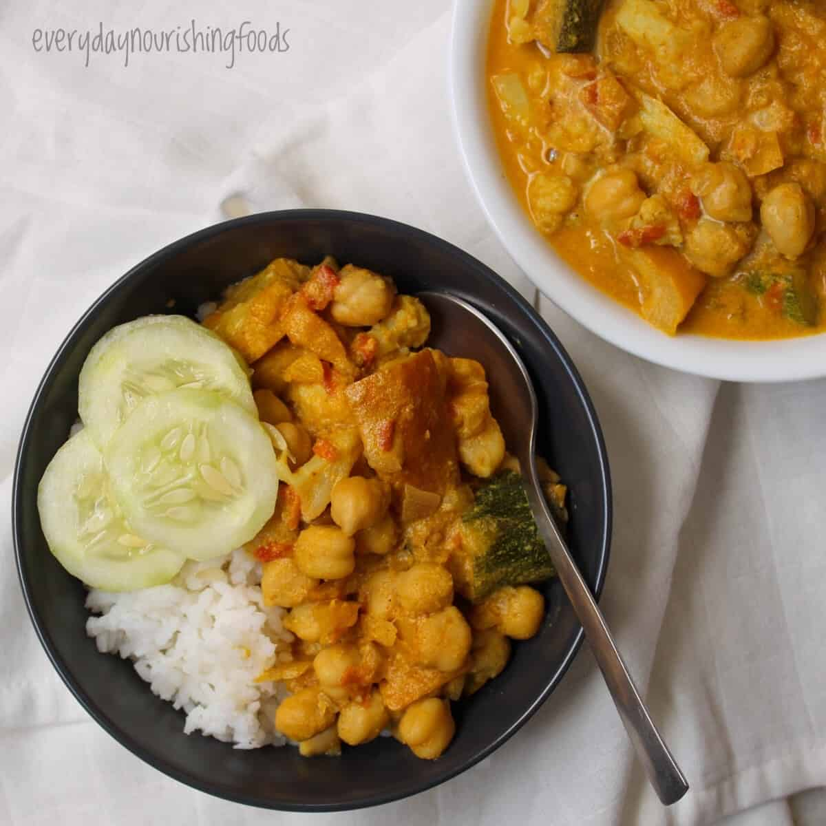 instant pot vegetable curry in a bowl along with rice